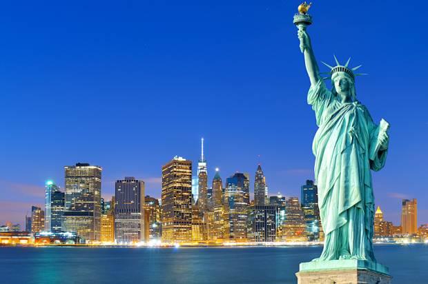 Manhattan at night; Statue of Liberty.
