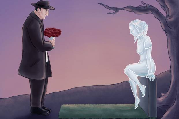 Man visiting grave