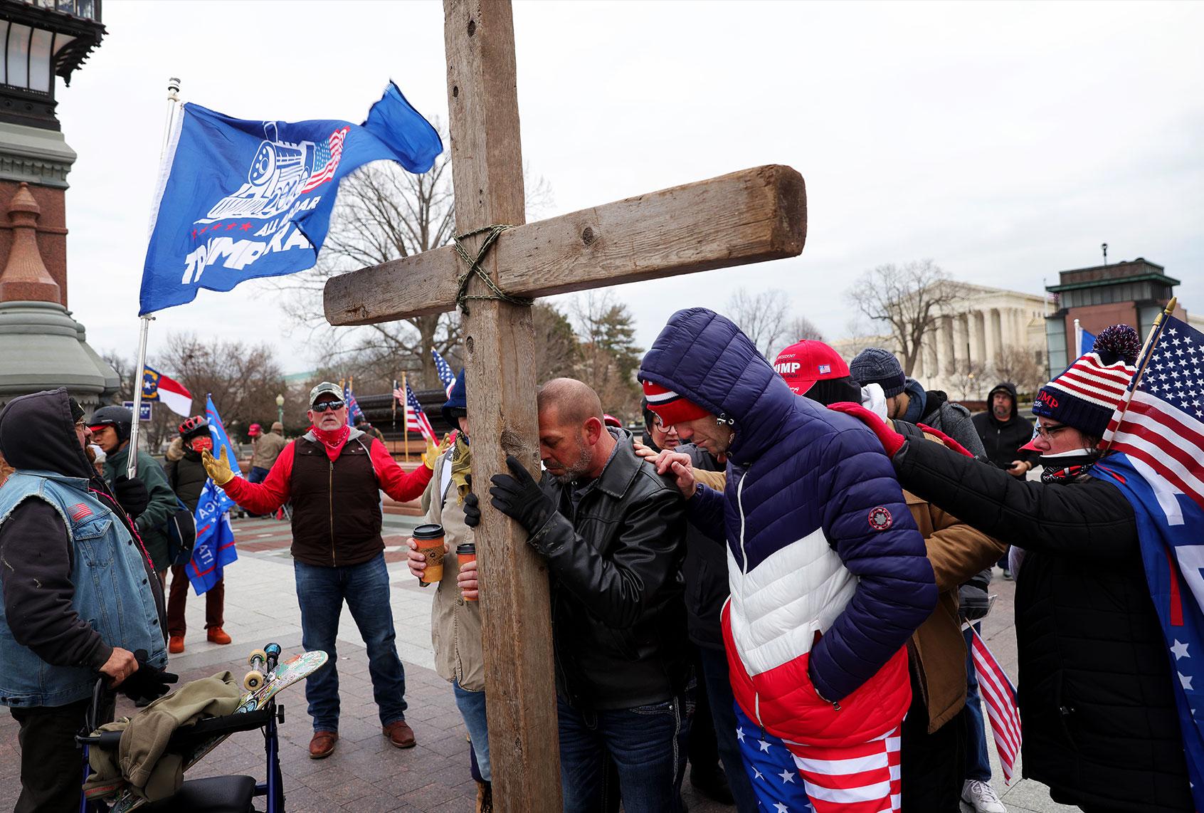 trump-supporters-praying-christian-cross
